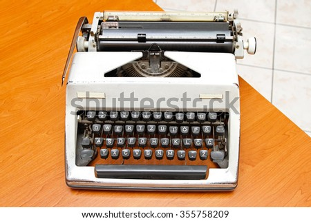 Retro style typewriter at office desk