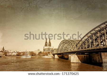 retro style View on Cologne Cathedral and Bridge, Germany - stock photo