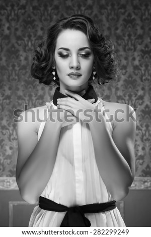 Retro style woman in vintage green room. Toned image. Professional make up and hairstyle - stock photo