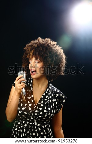 retro style young woman performing on stage geniune lens flare - stock photo