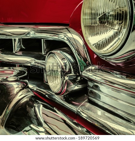 Retro styled front of a classic red car - stock photo