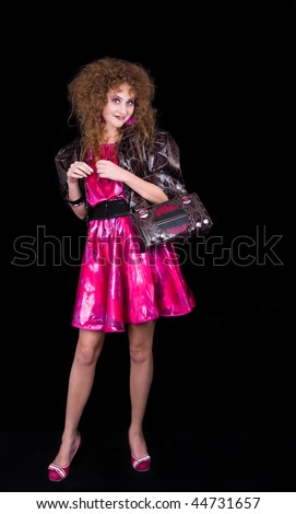 Retro styled girl with handbag like radio receiver - stock photo
