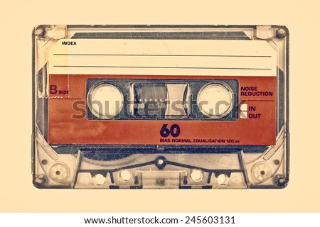 Retro styled image of an old compact cassette with empty label - stock photo