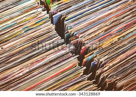 Retro styled image of boxes with vinyl turntable records on a flee market - stock photo
