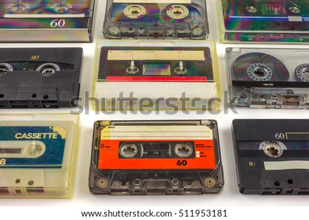 Retro styled image of different vintage audio compact cassettes