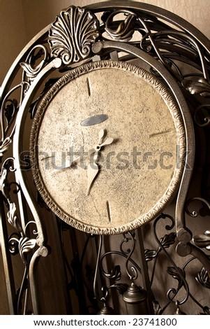 retro-styled iron clock - stock photo