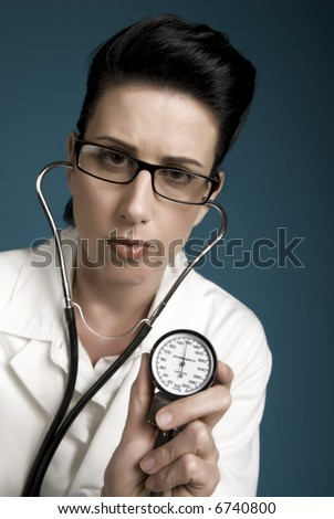 Retro styled medical professional showing high blood pressure results - stock photo