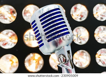 retro styled microphone. Selective focus. - stock photo