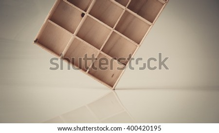 Retro styled or retro color wooden box compartment or cabinet on empty background. Slightly de-focused and close-up shot. Copy space. - stock photo