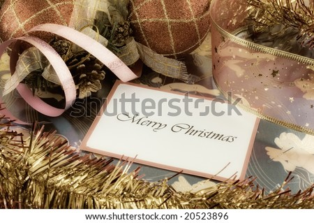 Retro styled photo of a Merry Christmas note among decorations with glow