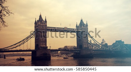 Retro styled photo of Tower Bridge in the sunset, London, UK