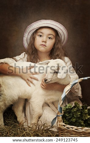 Retro styled portrait of a little girl with a baby goat - stock photo
