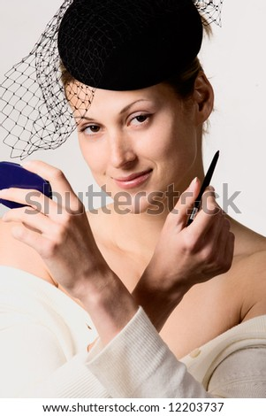 Retro styled portrait of pretty woman with veil - stock photo