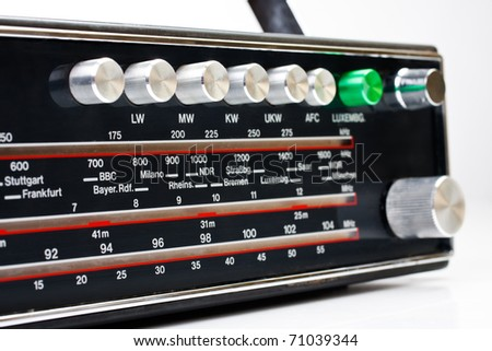 Retro styled radio receiver isolated on white - stock photo