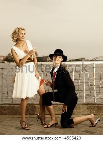 Retro stylized portrait of two beautiful girls near the river - stock photo