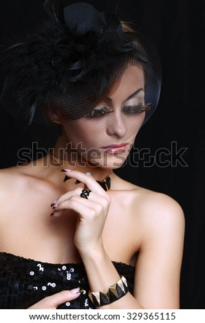 Retro-stylized woman in black hat with veil  - stock photo