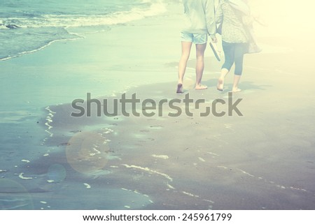 Retro sunny summer sea love couple walking on sand with sea wave. - stock photo