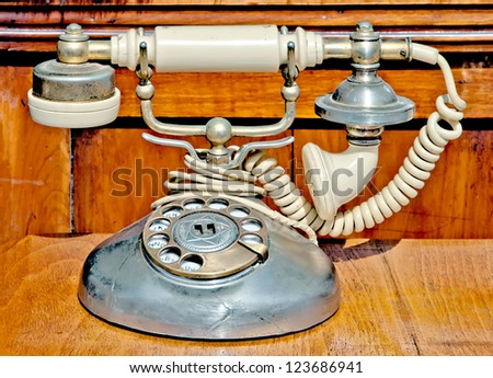 Retro telephone on a flea-market table - stock photo