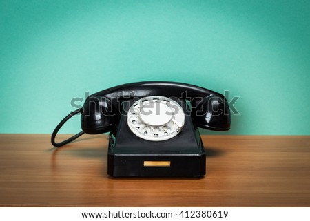 Retro telephone on table - stock photo