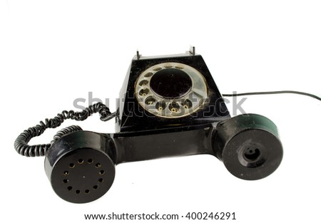 Retro telephone on table in front mint green background / old phone in front of a dark background  / Phone / Old black Rotary Telephone handset / old phone on white background  - stock photo