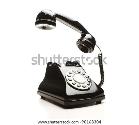Retro telephone on white background - stock photo