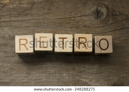 Retro text on a wooden background - stock photo