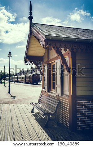 Retro touristic train station  - stock photo