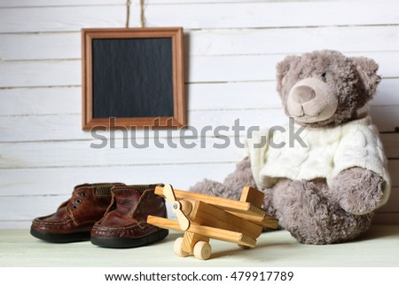 retro toy on wooden board place text