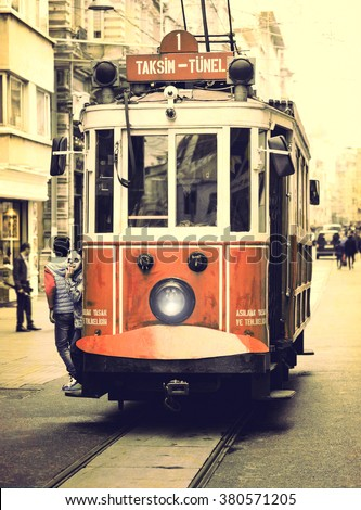 Retro tram on Istiklal street of Istanbul. Old red train - vintage city transport. Tramway, view at front, trip on the old tram. - stock photo