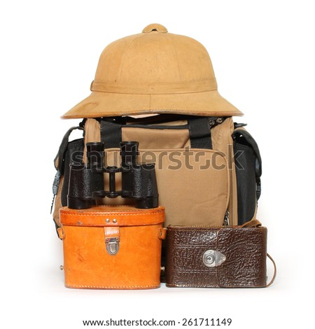 Retro travel baggage with tropical hat and binocular. - stock photo
