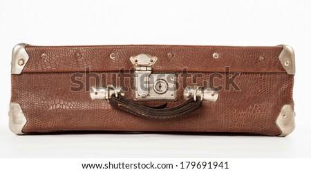 Retro travelling suitcase on white background - stock photo