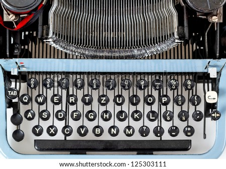 retro typewriter close up with detail of keys and letters mechanism - stock photo