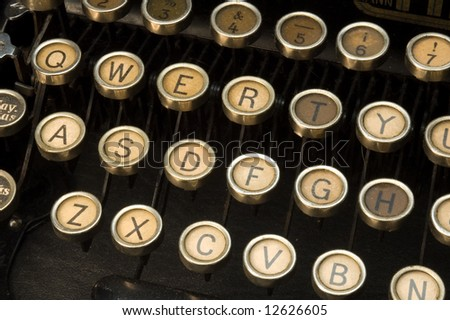 retro typewriter closeup on QWERTY keys - stock photo