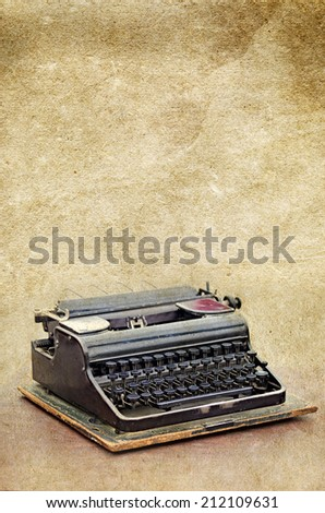 retro typewriter on the old vintage textured paper background collection - stock photo