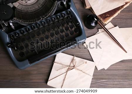 Retro typewriter on wooden table, top view - stock photo