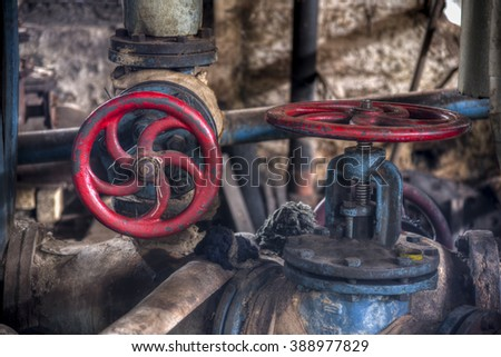 Retro valves in heavy industry factory in Gondang Baru, Indonesia - stock photo