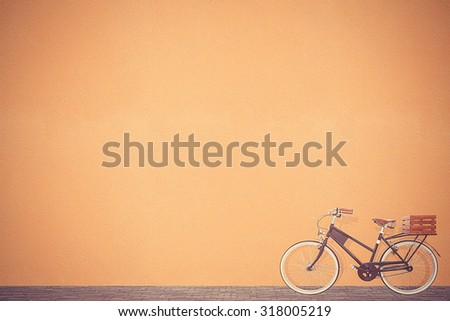 retro vintage bicycle old and brown wall background design - stock photo