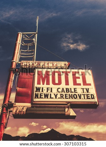 Retro Vintage Image Of Old Motel Sign In Small Town USA In The Mountains - stock photo