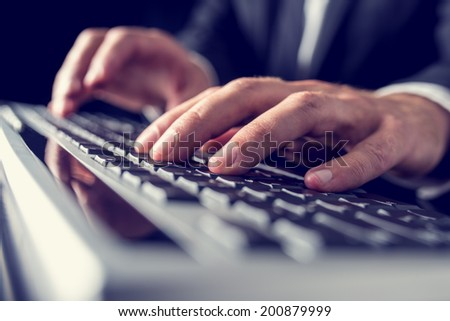 Retro vintage or instagram style image of a businessman typing on computer keyboard.  - stock photo