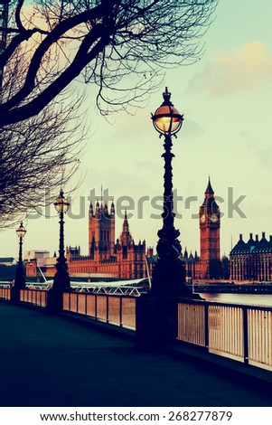 RETRO VINTAGE PHOTO FILTER EFFECT: Lamp on South Bank of River Thames with Big Ben and Palace of Westminster in Background, London, England, UK - stock photo