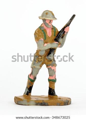 Retro, vintage plastic Toy Soldiers on white background - stock photo