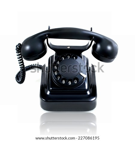 Retro vintage rotary telephone isolated on a white background - stock photo