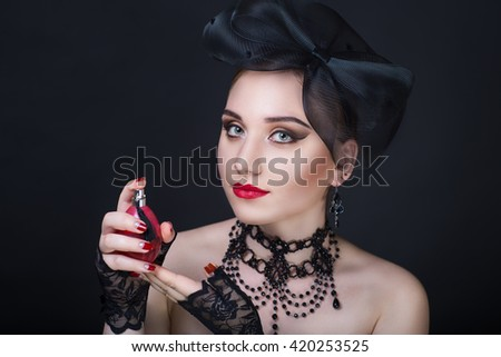 Retro vintage style black hat, gloves lace patterns, luxurious decoration on sexy neck old-fashioned necklace and earrings. Red manicure professional make up red lips, golden shadows decorates eyes - stock photo