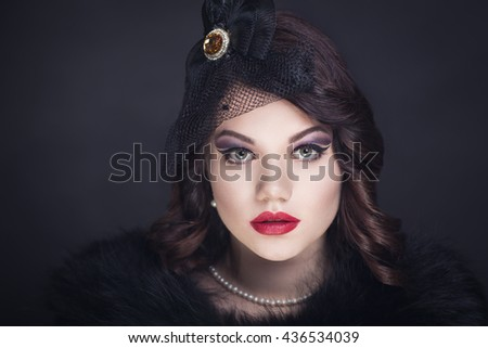 Retro vintage style black hat lace patterns, luxurious decoration on sexy neck pearls old-fashioned necklace curly hair brunette. professional make up red lips golden shadows decorates eyes Horizontal - stock photo