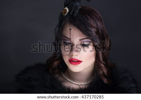 Retro vintage style black hat lace patterns, luxurious decoration on sexy neck pearls old-fashioned necklace curly hair brunette. professional make up red lips golden shadows decorates eyes Horizontal
