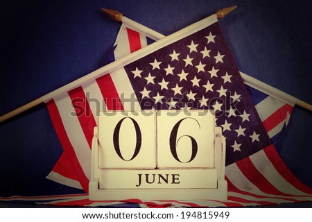 Retro vintage style D-Day calendar for anniversary of 6 June against a dark blue grunge background and USA stars and stripes and British UK Union Jack flags - stock photo
