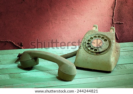 Retro vintage telephone still life in grunge style - stock photo
