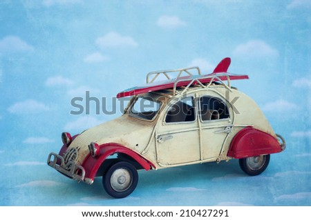 Retro Vintage Tropical Surfboard Car - stock photo