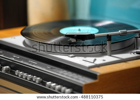 Retro vinyl player with a vinyl disk on a stand