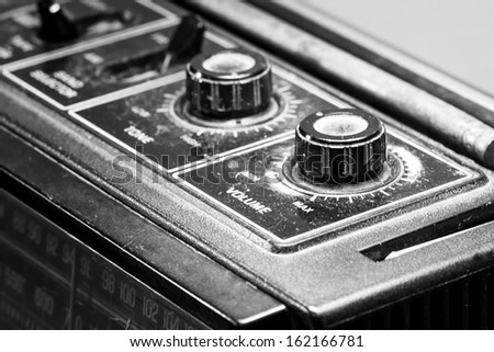 Retro volume button on the top of cassette player. - stock photo